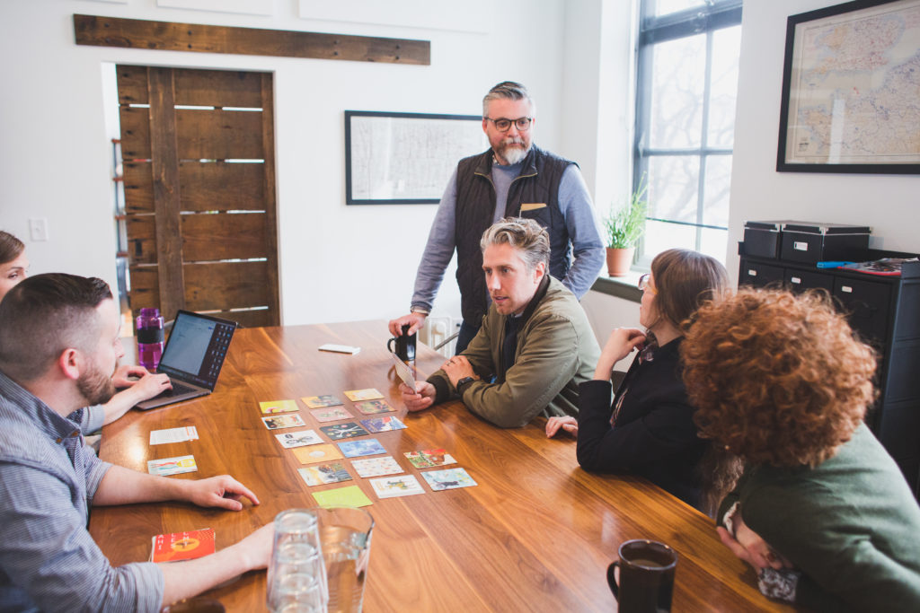 A photo of a client holding and discussing an archetype card during Infantree's archetype workshop.